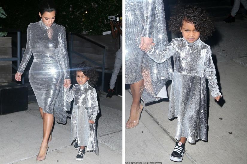 Kim Kardashian w srebrnej sukience z małą North West